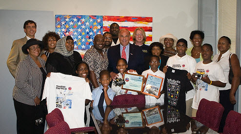 Honoring robotics team from Shaw Middle School on their successful return from competing in an invitational competition in Japan with PA Governor Rendell (red tie) at his office.  The Mid Atlantic partnered with NASA, its Explorer School and Drexel University to help the students explore experimental science through history and robotics.