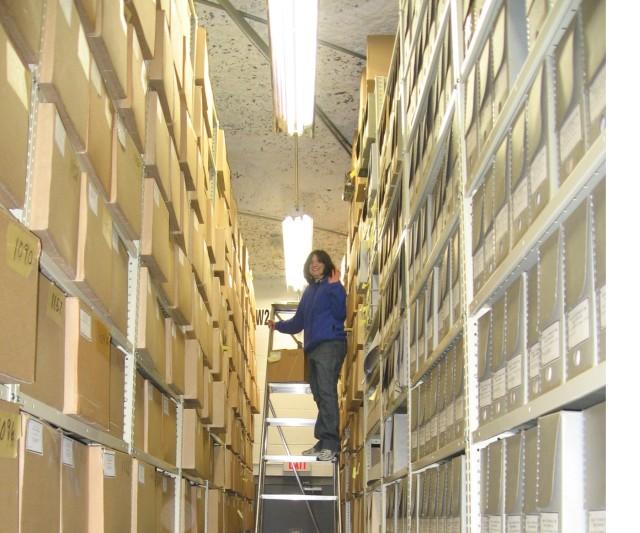 Denise Henderson describes archival records in off-site storage in Lee's Summit, Missouri