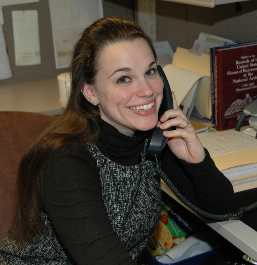 Natalie Rocchio speaking on the phone at her desk