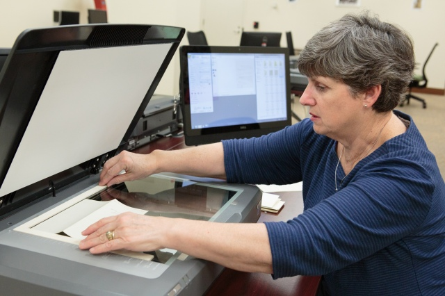 Citizen Archivist Cindy Norton scans records in the Innovation Hub. Photo by Jeffrey Reed