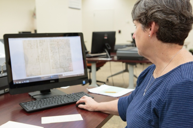 Citizen Archivist Cindy Norton reviews her scans in the Innovation Hub. Photo by Jeffrey Reed