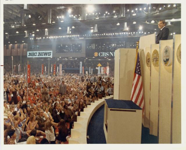 Richard Nixon standing at podium during campaign, 1972