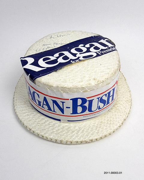Reagan-Bush campaign hat with bumper sticker, 1980. Reagan Library.